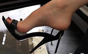 Kelly Cleft high arched limbs in flick through flops and high heels parking lot
