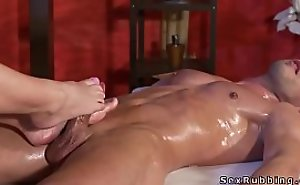 Blonde masseuse gives massage with paws