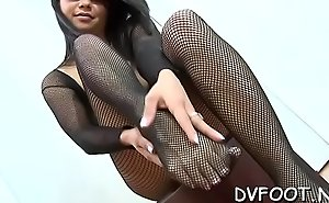 Nice chick gets out her sexy feet and grinds one-eyed monster and balls
