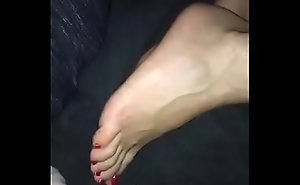 Cumming on her cute feet